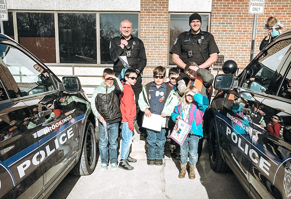 Officers with Cub Scouts