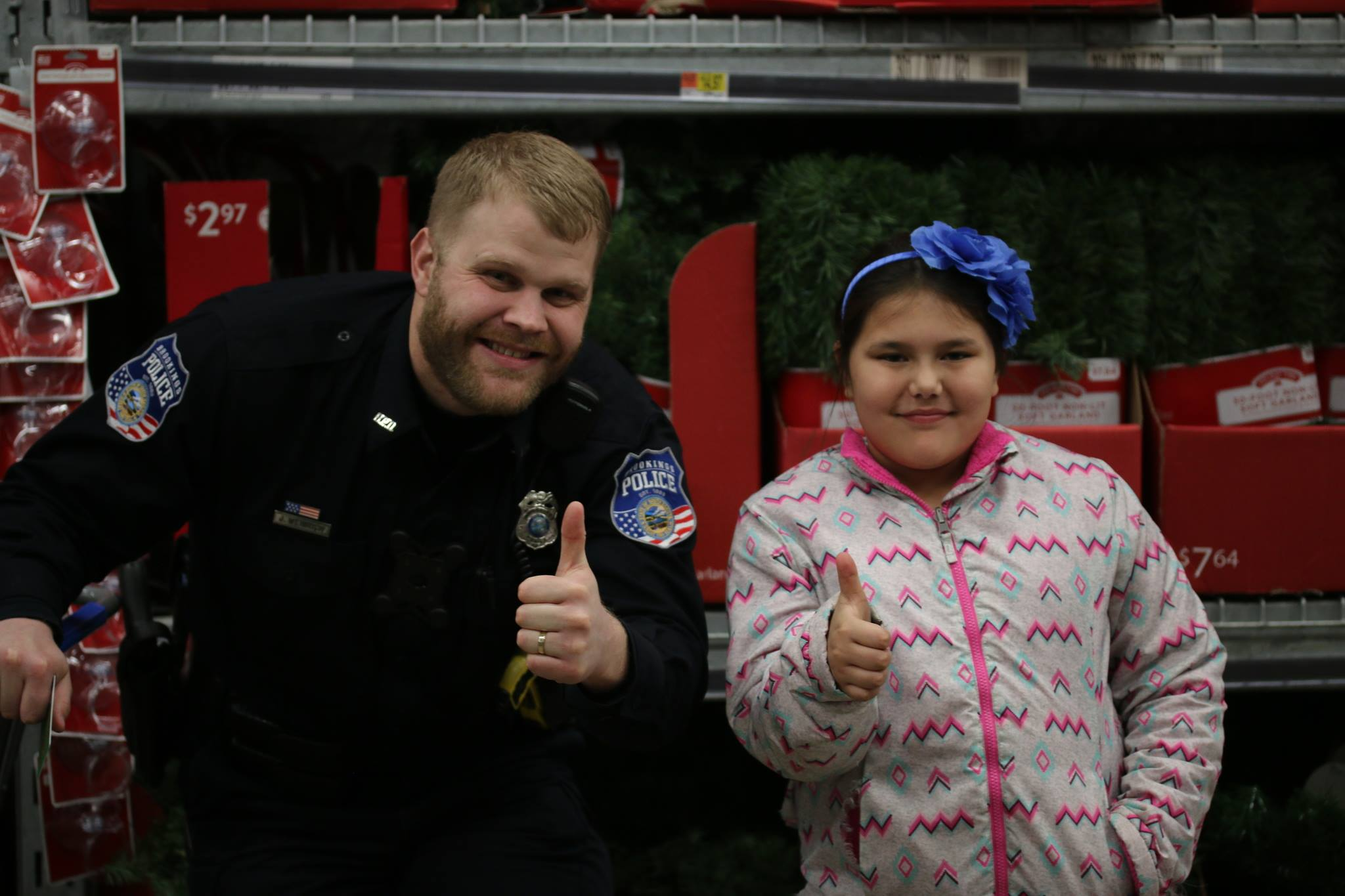 Officer and Kid at Christmas Kids and Cops
