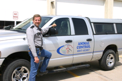 Animal control officer with his truck